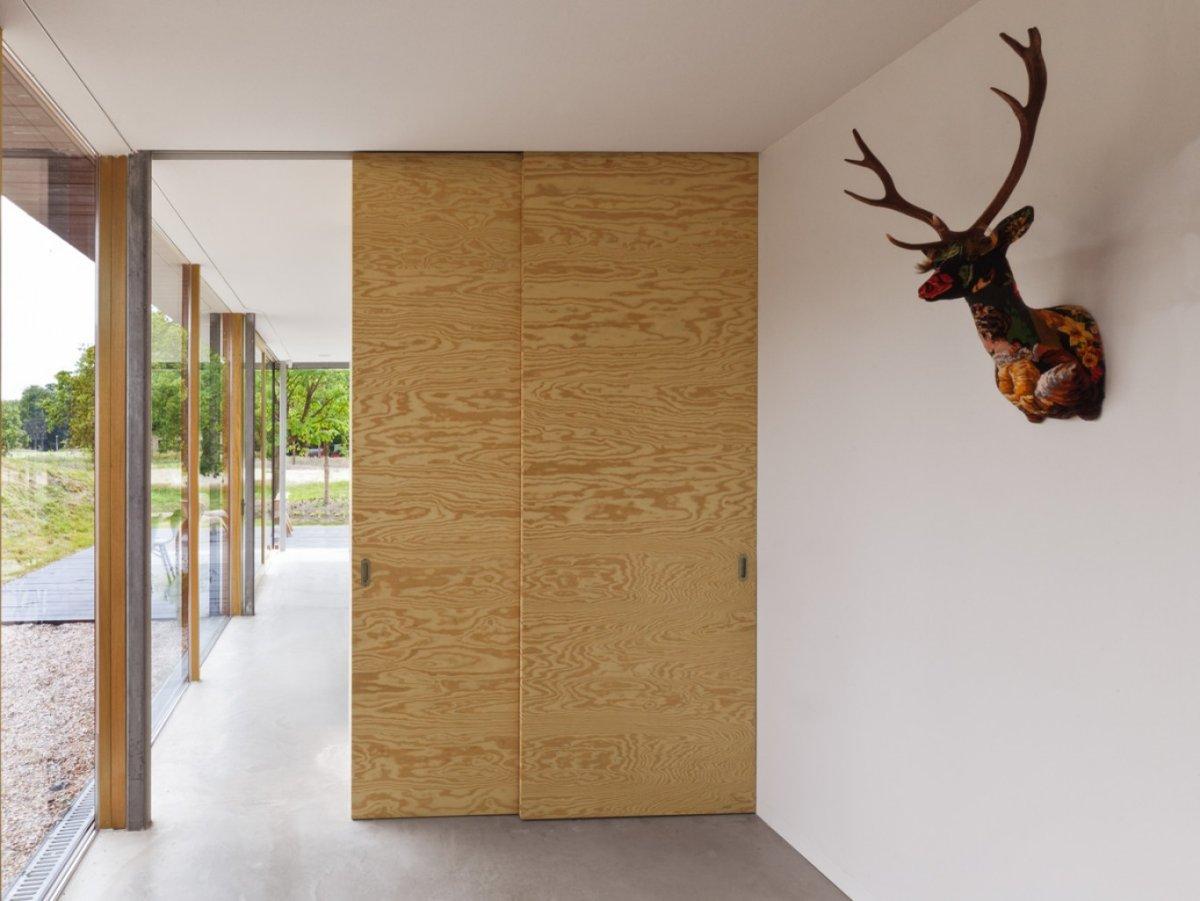 Porte coulissante en bois brut for Portes coulissantes en bois